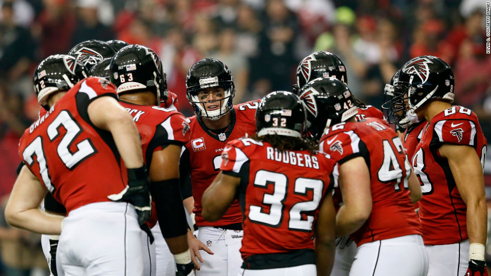 Falcons quarterback Matt Ryan, center, talks to his team in a huddle during the first half against the 49ers.