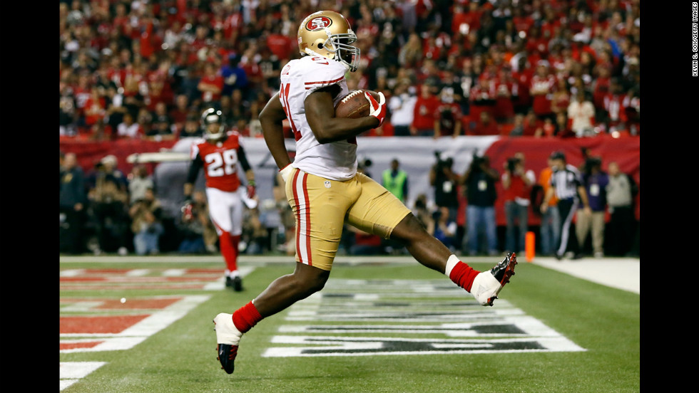Frank Gore of the San Francisco 49ers scores a five-yard rushing touchdown in the third quarter.