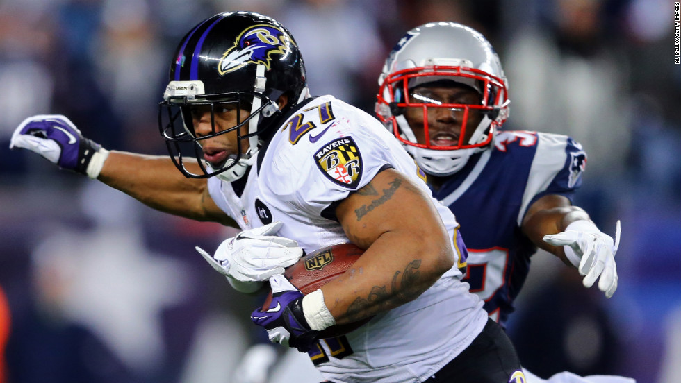 Ray Rice of the Ravens runs the ball against Devin McCourty of the Patriots.