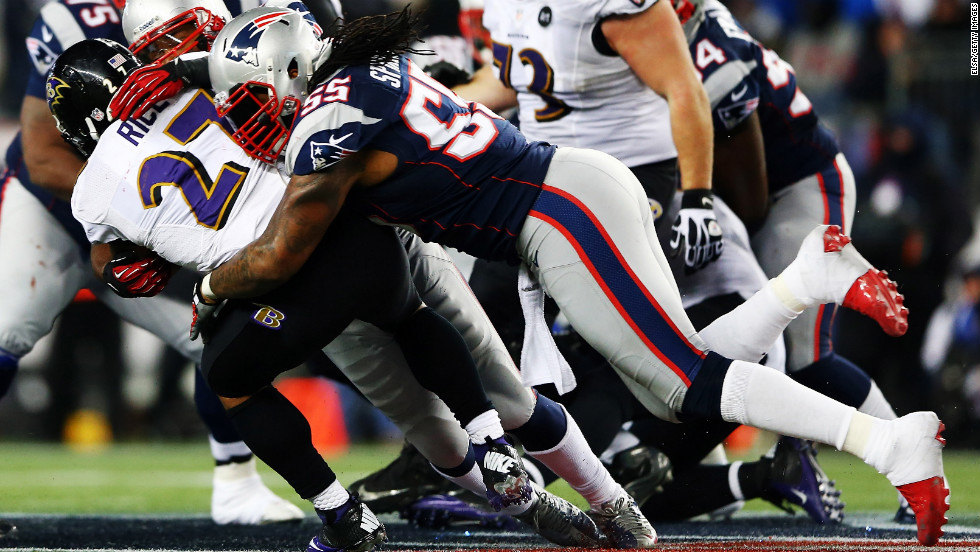 Brandon Spikes of the New England Patriots tackles Ray Rice of the Baltimore Ravens.