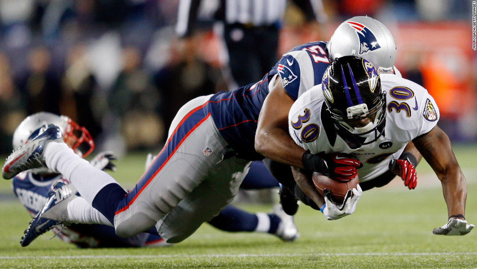 Jerod Mayo of the Patriots tackles Bernard Pierce of the Baltimore Ravens.