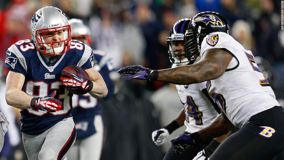 Wes Welker of the Patriots runs with the ball against the Baltimore Ravens.