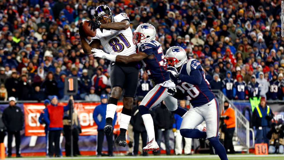 Anquan Boldin of the Ravens scores a touchdown against the Patriots.