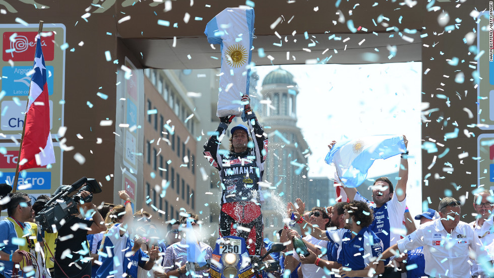 Marcos Patronelli of Yamaha Racing Team Argentina,  who won first place in the all-terrain vehicle category, celebrates during the podium presentations at the end of the 2013 Dakar Rally on Sunday, January 20, in Santiago, Chile. The dangerous, 16-day rally is an annual off-road race for motorcycles, ATVs, cars and trucks that takes place in Peru, Argentina and Chile. Three people died in this year's race.