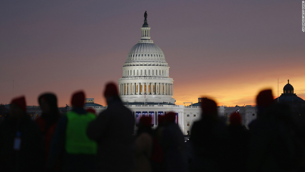 People gather near the Capitol on the National Mall for Monday's inauguration ceremony.