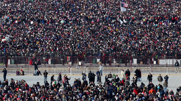 Crowds await the start of the presidential inauguration Monday on the Capitol