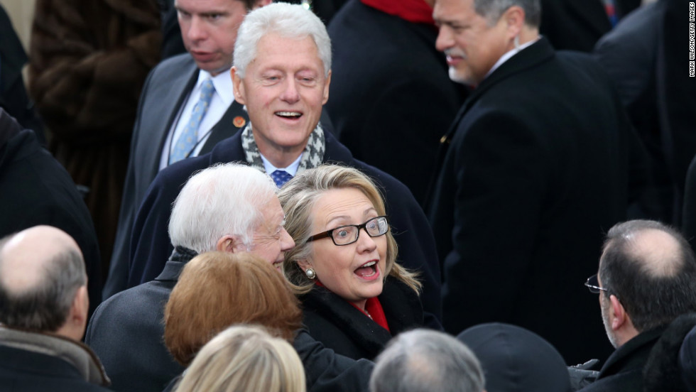 U.S. Secretary of State Hillary Clinton, former President Bill Clinton and former  President Jimmy Carter greet the crowd Monday.