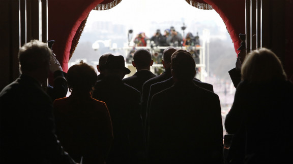 Obama, center, pauses before walking out the door of the U.S. Capitol to begin swearing-in ceremonies on January 21.