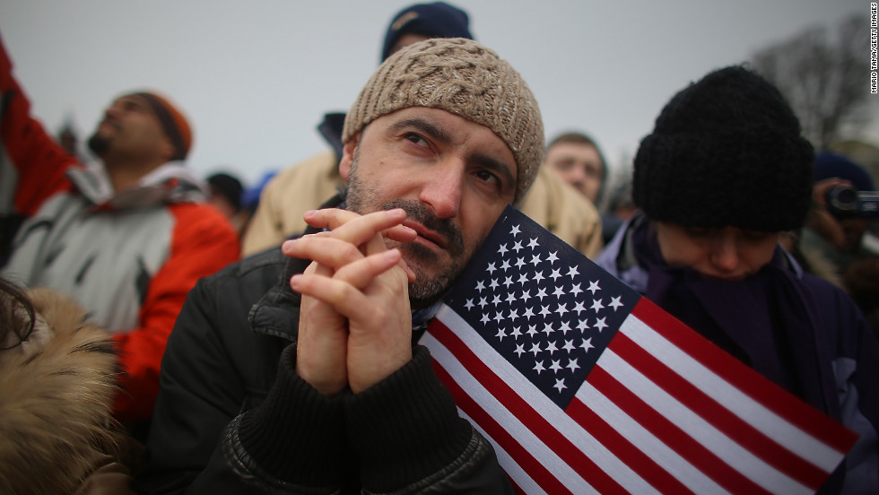 Igor Naumovski is among the flag-waving celebrants on the National Mall during the inauguration ceremony on Monday, in Washington.