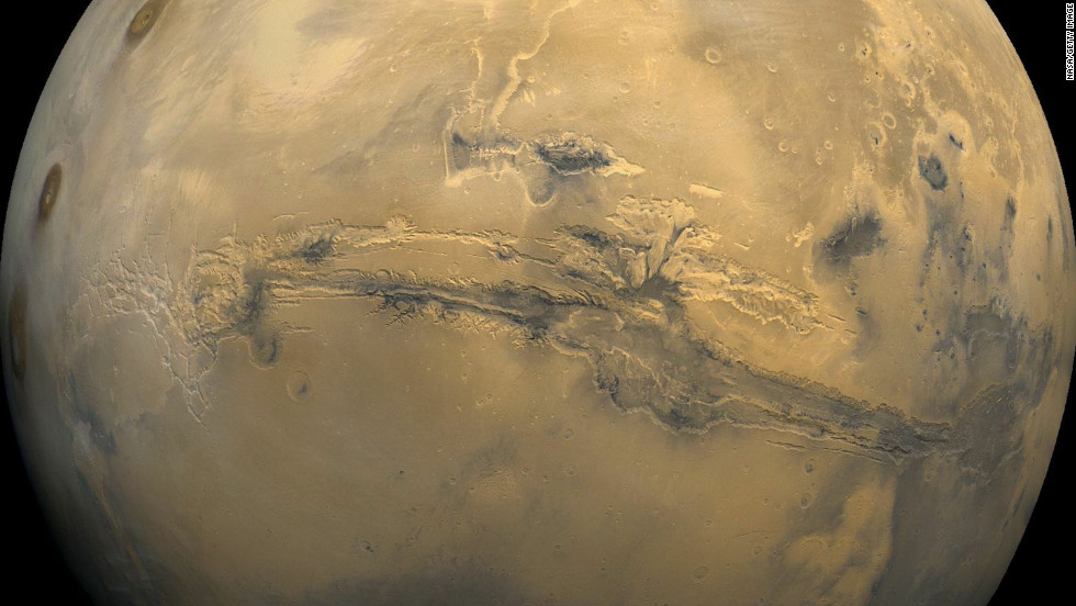 The Valles Marineris, shown in this composite image of Mars, is similar to Arizona's Grand Canyon, except it's as long as the U.S. is wide. Scientists theorize that water might have carved canyons like Valles Marineris after asteroids slammed into the Martian surface and melted underground ice.