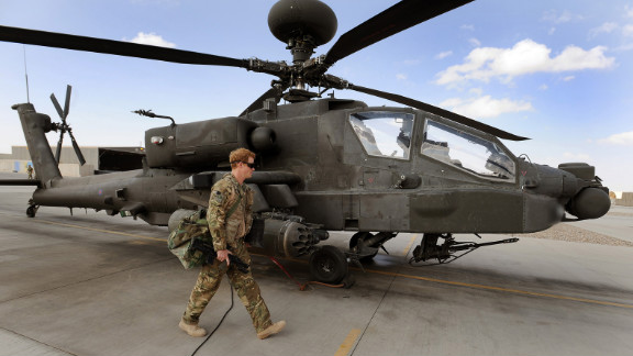 Harry inspects an Apache helicopter on October 30, 2012.