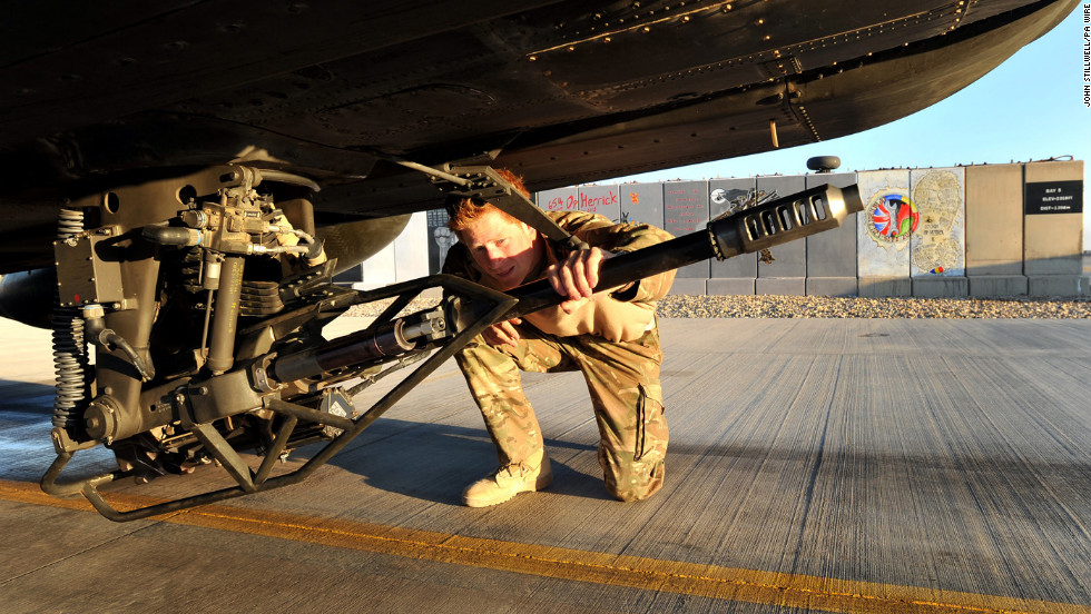 Harry performs a preflight check on an Apache helicopter on January 11.