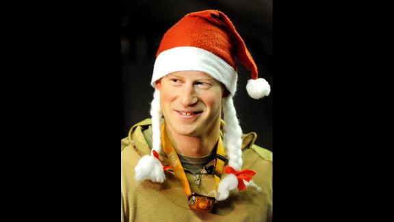 Harry wears a Santa hat on December 12, 2012.