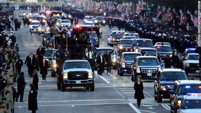 President Barack Obama travels along a stretch of parade route along Pennsylvania Avenue during the 57th presidential inauguration on Monday, January 21, in Washington DC.