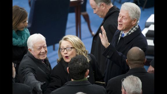 Former President Jimmy Carter, left, Secretary of State Hillary Clinton, center, and former President Bill Clinton arrive at the Inauguration for President Obama