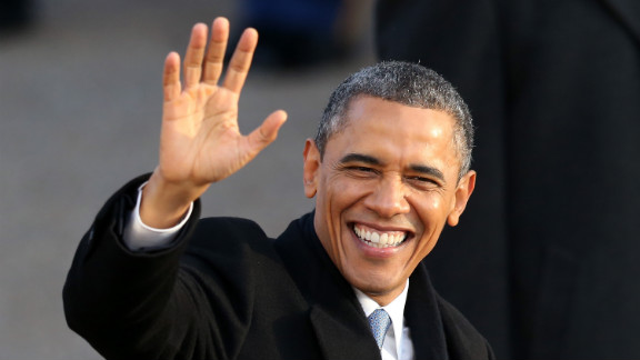 President Obama waves as the presidential inaugural parade winds through the nation