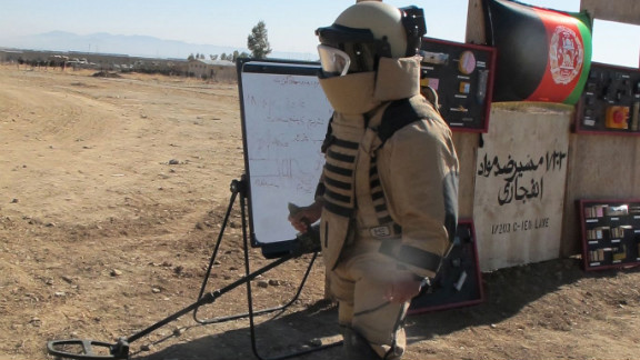 A bomb-suited soldier with the Afghan National Army trains to defuse explosives in Khost Province, eastern Afghanistan.