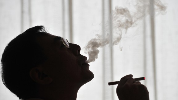 The inventor of the electronic cigarette, Hon Lik smokes his invention in Beiijng on May 25, 2009.