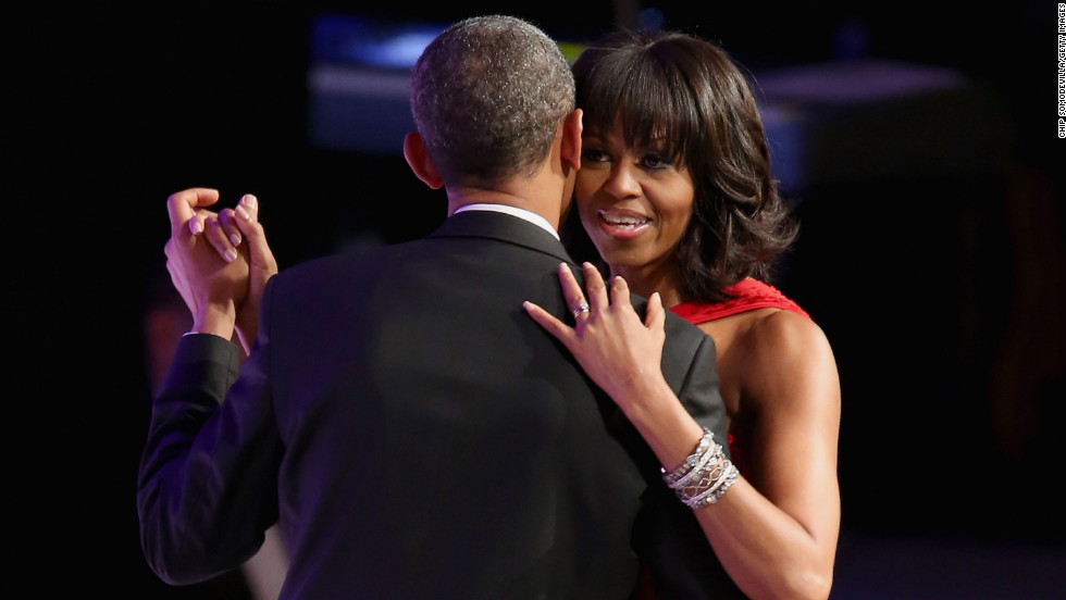 Michelle Obama dances cheek to cheek with President Obama.