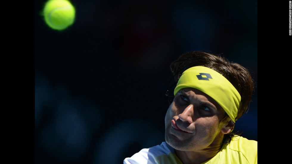 Spain's David Ferrer watches the ball during his men's singles match against compatriot Nicolas Almagro on January 22. Ferrer defeated Almagro 4-6, 4-6, 7-5, 7-6 (4), 6-2.