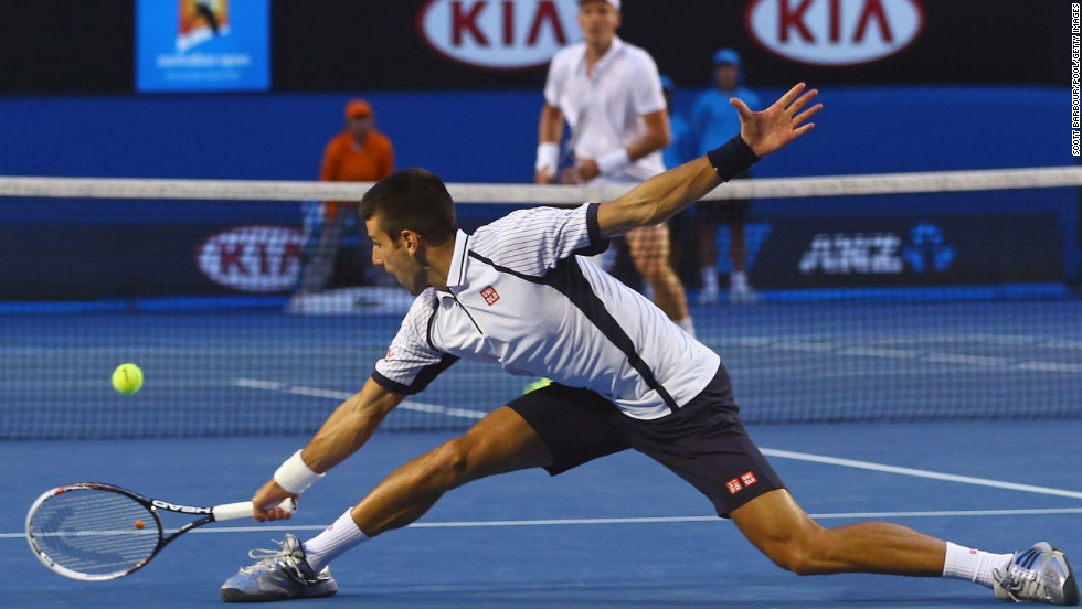 Novak Djokovic of Serbia stretches for the ball in his quarterfinal match against Tomas Berdych of the Czech Republic on Tuesday, January 22. Djokovic won 6-1, 4-6, 6-1, 6-4.