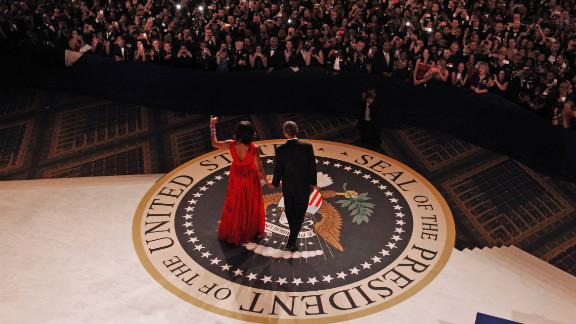 President Barack Obama and first lady Michelle Obama head out for their first dance together at the Commander-in-Chief
