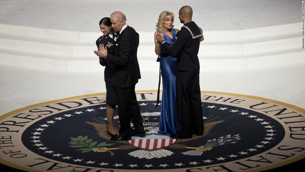 Vice President Joe Biden and his wife, Jill Biden, each dance with service members at the Commander-in-Chief's Ball on January 21.