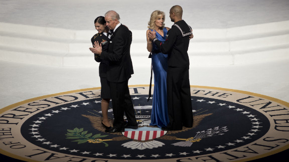 Vice President Joe Biden and his wife, Jill Biden, each dance with service members at the Commander-in-Chief
