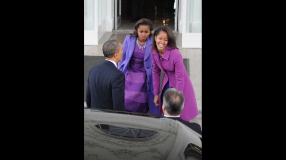 The president and his daughters return to the White House from prayer services at St. John