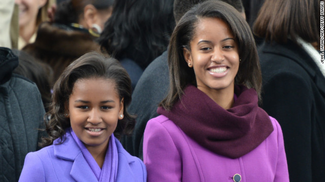 First daughters Sasha (L) and Malia arrive for the 57th Presidential Inauguration ceremonial swearing-in of President Barack Obama at the US Capitol on January 21, 2013 in Washington, DC. The oath is to be administered by US Supreme Court Chief Justice John Roberts, Jr.    AFP PHOTO/Jewel Samad        (Photo credit should read JEWEL SAMAD/AFP/Getty Images)