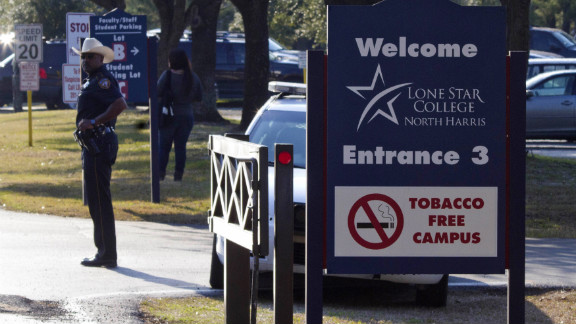 A sheriff's deputy stands guard at the entrance to Lone Star College's North Harris campus on January 22. The campus was put on lockdown following reports of the shooting.