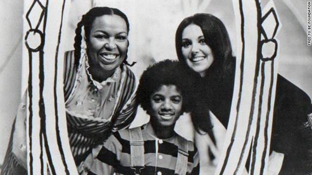"Roberta Flack, Michael Jackson and Marlo Thomas pose during filming of ""Free to Be...You and Me"" television special in 1974."
