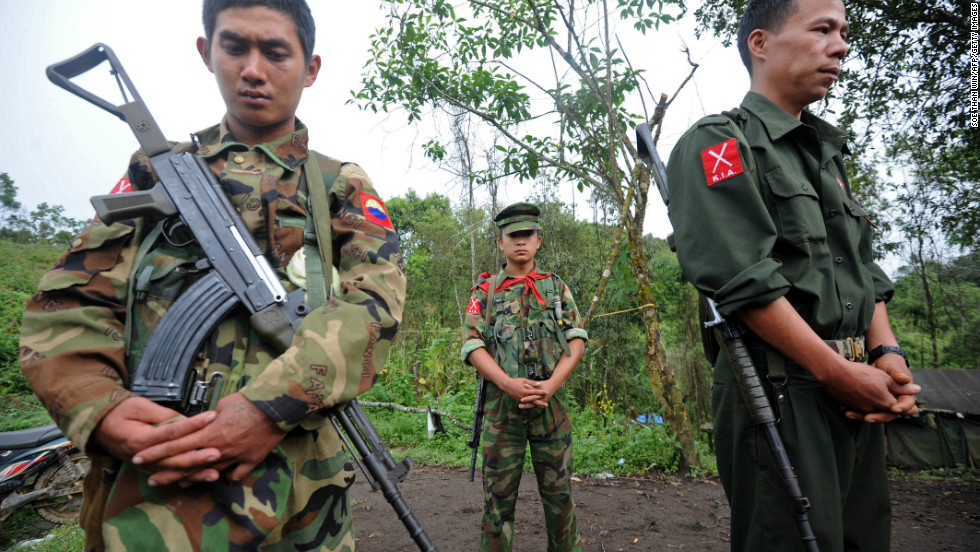 KIA soldiers pray before taking their positions at a frontline camp near Mai Ja Yang, outside Laiza, in September 2012. Kachins are predominantly Christian Baptists and Roman Catholics, unlike the majority of people in Myanmar who practice Buddhism.