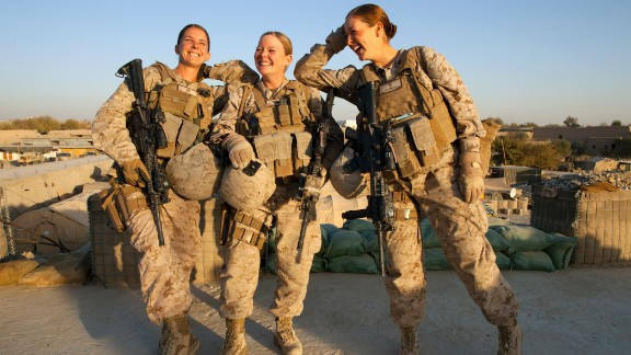 From left, Marines Sgt. Sheena Adams and Lance Cpl. Kristi Baker and Navy Hospital Corpsman Shannon Crowley work with a Female Engagement Team in Afghanistan in November 2010.