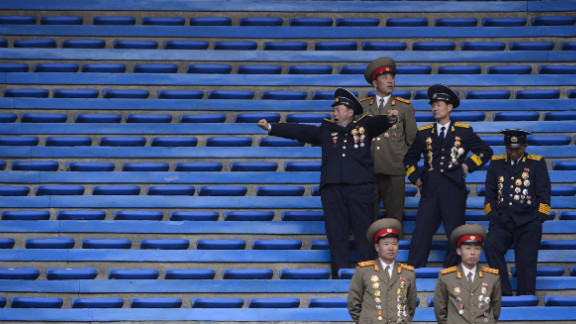 North Korean soldiers relax at the end of an official ceremony attended by leader Kim Jong Un at a stadium in Pyongyang in April 2012.