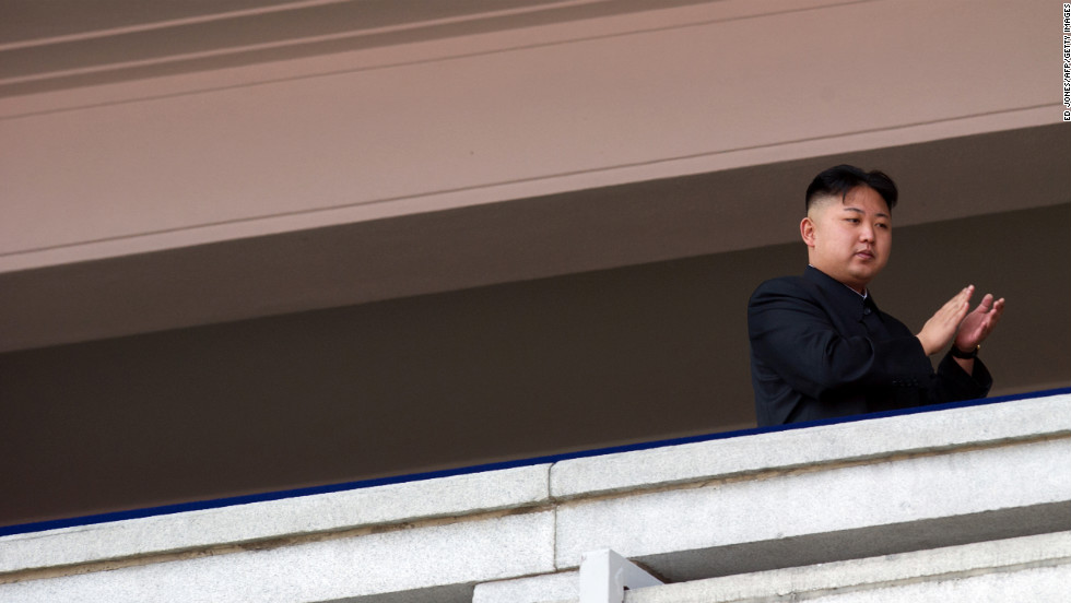 Kim Jong Un applauds as he watches a military parade in Pyongyang in April 2012.