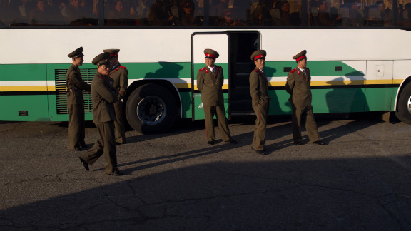 Soldiers board a bus outside a theater in Pyongyang in April 2012.