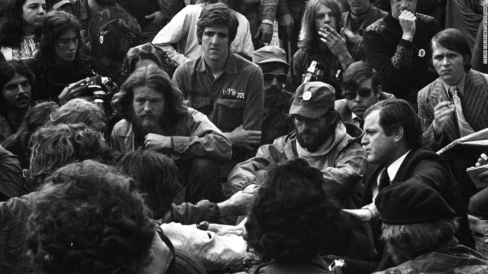 Kerry listens to Sen. Ted Kennedy as he speaks to Vietnam veterans during a demonstration by Vietnam Veterans Against the War in Washington in May 1971.
