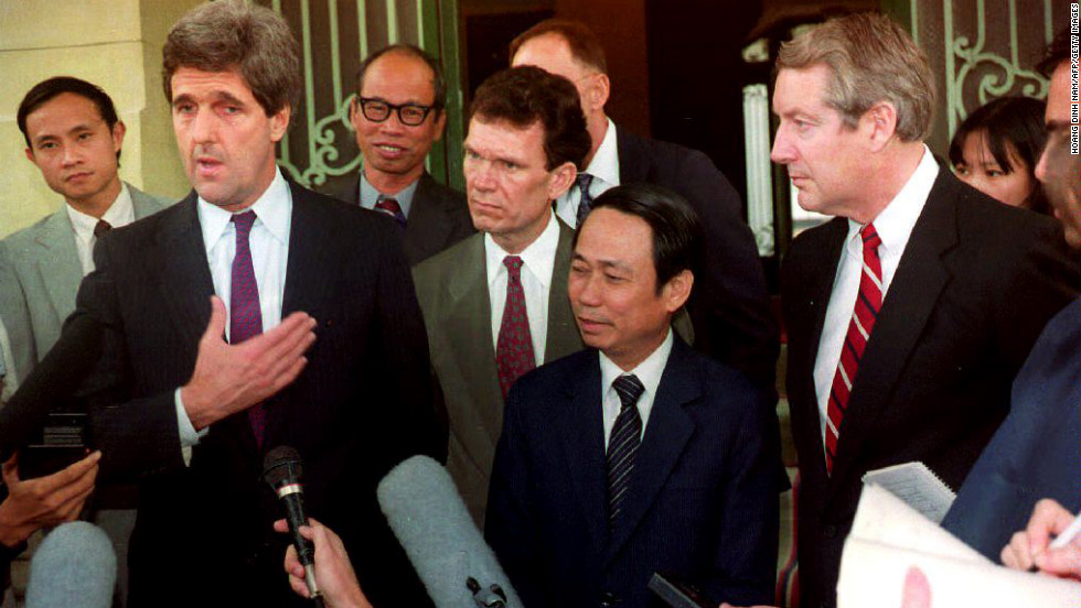 Kerry and Vietnamese Deputy Foreign Minister Le Mai, second from right, talk with reporters after the arrival of Kerry, Sen. Hank Brown and Sen. Tom Daschle on November 16, 1992, for talks with the Vietnamese government on the fate of U.S. servicemen still missing after the war.