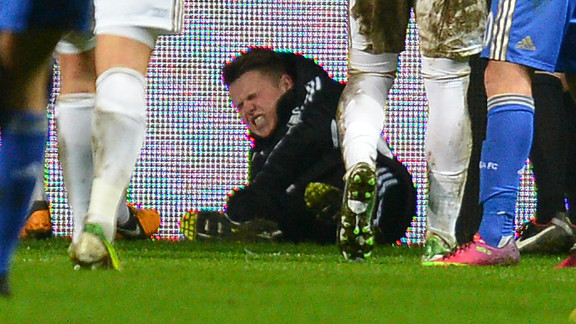 Swansea ball boy Charlie Morgan grimaces after the incident which led to Eden Hazard's sending off.
