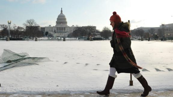 A woman walks past the U.S. Capitol on Jan. 24, 2013 in Washington, D.C.