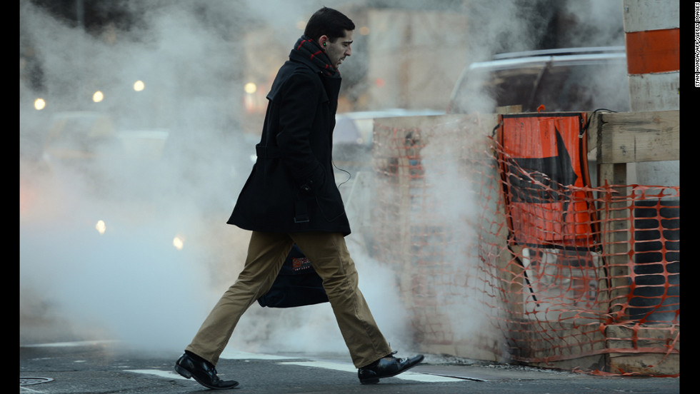 A man walks past a steam vent on Madison Avenue in Manhattan in the early morning of January 24.