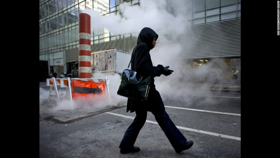 A woman pulls on her gloves on January 23 in New York.
