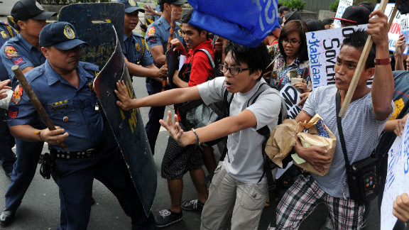 Student activists scuffle with police in front of the U.S. Embassy in Manila during a January 19 protest condemning the minesweeper