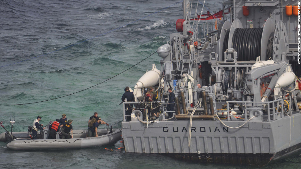 A U.S. Navy salvage assessment team boards the USS Guardian on Wednesday, January 23, in the Sulu Sea.