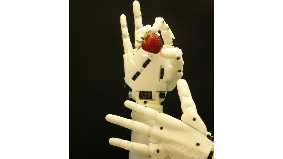 InMoov's hands now have fully articulated fingers and silicone padding to help it grasp objects.