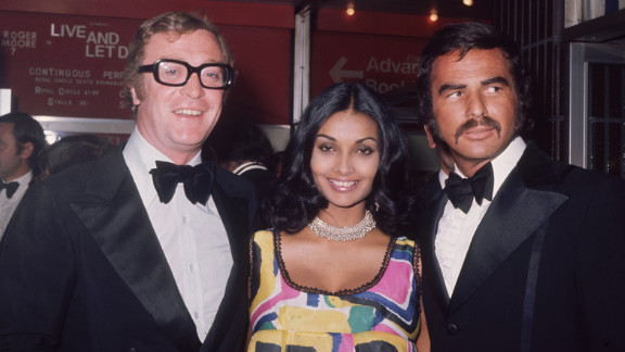"""In 1973, Reynolds attends the premiere of """"Live and Let Die"""" with Michael and Shakira Caine."""