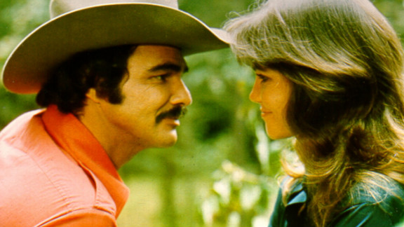 """Reynolds appears with Sally Field in 1977's """"Smokey and the Bandit."""""""