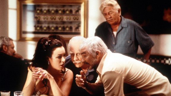 """Reynolds gets close to Jennifer Tilly and Richard Dreyfuss in 2000's """"The Crew."""""""