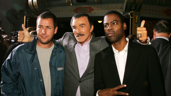 """Reynolds poses with Adam Sandler, left, and Chris Rock after a remake of """"The Longest Yard"""" in 2005."""